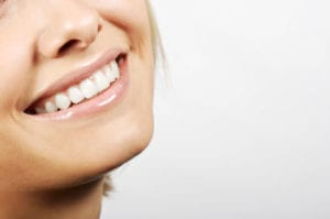 A healthy smile after metal-free treatment by a holistic dentist.