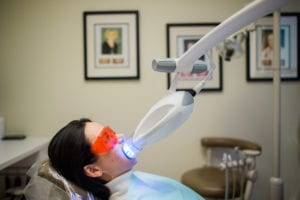 A patient receiving the Zoom! whitening treatment by Dr. Tostado.