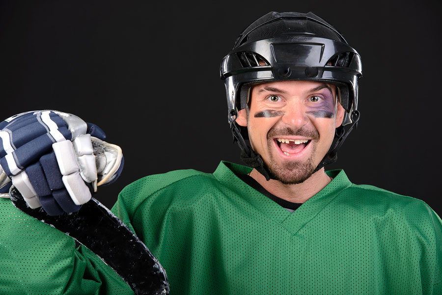 A hockey player with a tooth knocked out
